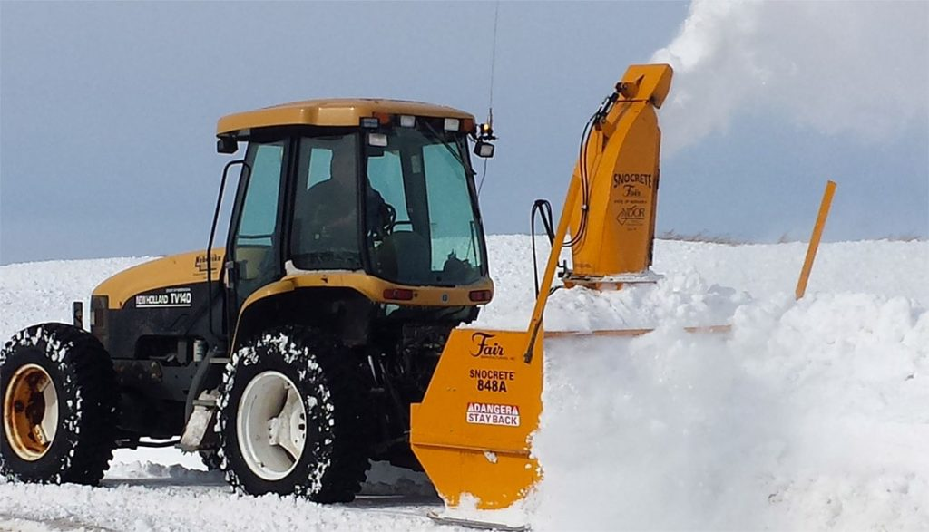 PTO driven snowblower working through snow drift