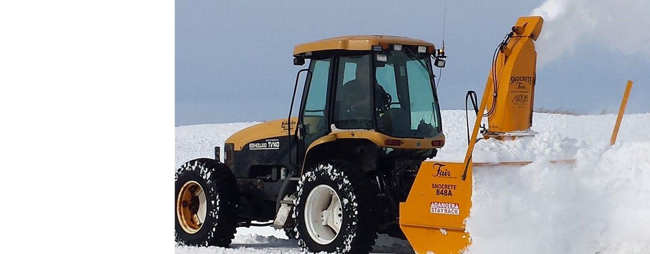 PTO driven snowblower working through snow drift