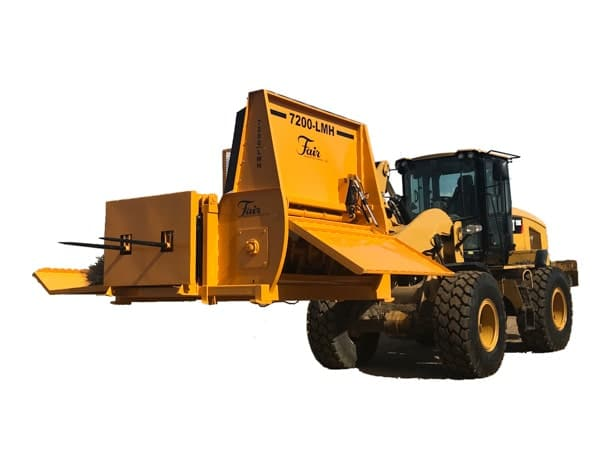 7200-LMH Bale Processor by Fair Manufacturing on a front end loader