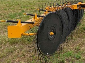 Fair Manufacturing Hay Rake - dual spring wheel suspension